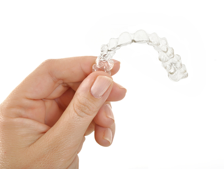 Determining what Insurance companies cover Invisalign clear aligners