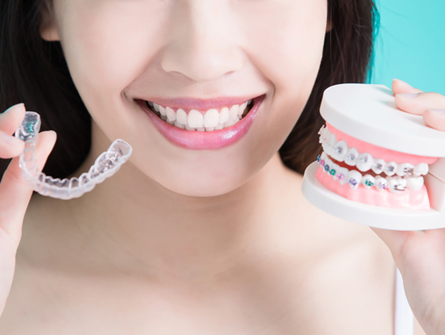 Woman considers the fees for broken brackets, wires, plates or lost aligners during teeth straightening treatments
