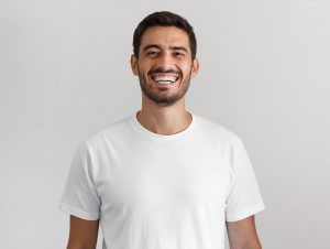 man smiles after reading positive suresmile reviews