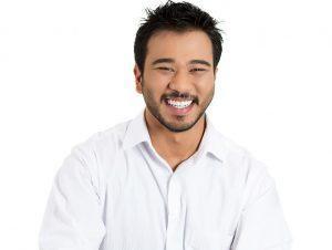 Man smiling after having self ligating ceramic braces.